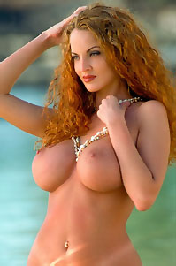 Busty Redhead Babe In Water