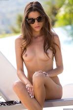 Seductive Brunette Valeria Stripping Naked Poolside 11